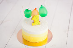 First birthday smash the cake. The cake with number one and little ballons. birthday greetings. Yellow polka dot cookie Stock Photo