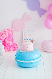First birthday smash the cake. A pink cake stands on a large blue macaroon. First birthday Royalty Free Stock Photos