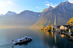 First Boat to Hallstatt. The First Boat approaching Hallstatt in the morning Stock Photo