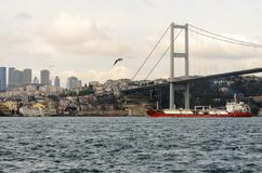First Bosphorus bridge with ship in transit, Istanbul, Turkey Royalty Free Stock Image