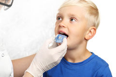 First braces, orthodontist child to the doctor. The little boy with braces Stock Image
