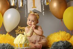 The first cake baby. Portrait of a child. Cake Smash stock photography