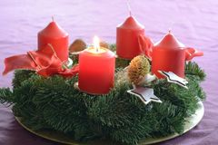 First candle is burning - optional picture. First candle on the Advent wreath is burning  - optional picture Royalty Free Stock Photography