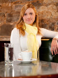 First capuccino-Beautiful girl drinking coffee Royalty Free Stock Photos