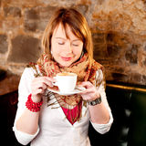 First capuccino - girl drinking coffee Royalty Free Stock Photos