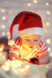 First Christmas. Babys first Christmas, portrait over party lights Royalty Free Stock Photos