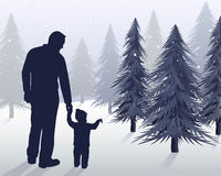 First Christmas Tree. A father & son pick out a Christmas tree together for the first time Royalty Free Stock Photos