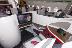 First Class Airbus A350. PARIS - JUN 18, 2015: First Class seat in a Qatar Airways Airbus A350. Qatar Airways is the first user of the A350 with it's first Royalty Free Stock Photography