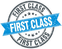 First class blue round grunge vintage stamp Stock Photos