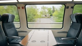 First class compartment in a moving high speed train. First class compartment in a high speed train stock footage