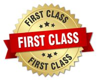 First class. Gold badge with red ribbon Stock Photos