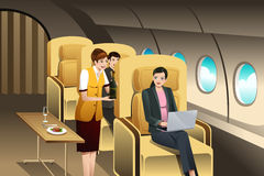First Class Passengers Being Served by the Flight Attendant Stock Photos