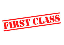 FIRST CLASS. Red Rubber Stamp over a white background Stock Photos