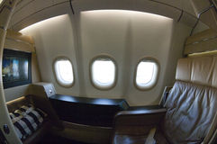 First class seat in an airbus. Commercial airbus with a first class window seat Royalty Free Stock Photo