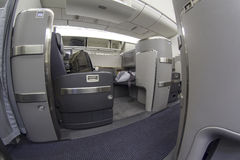 First class seat on Boeing 777-300 in a commercial airplane Royalty Free Stock Images