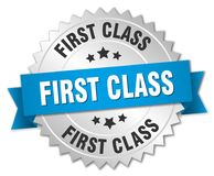 First class. Silver badge with blue ribbon Stock Photos