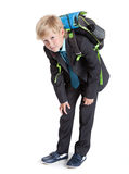 First class student holding heavy schoolbag on the back, full length, isolated white background Stock Image