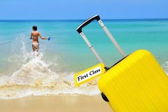 First Class. suitcase with label. Stock Photos