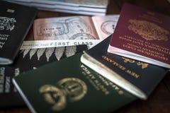 Passports and Visa. First class ticket among passports and visa stock photography