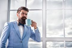 But first coffee. Man groom drinking coffee early in morning. Beginning of great day. Important day in his life. Get. Ready. Enjoy every minute. Hipster in royalty free stock images
