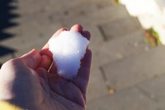 The first cold snow in the warm hand royalty free stock photos