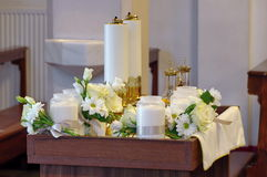 Catholic service. First Communion. Candles and white flowers. Catholic service. Candles and white flowers used for the First Communion Stock Photography