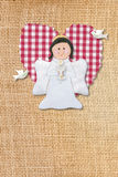 First communion card, angel. Cheerful first communion card, angel in burlap background Stock Photos