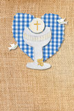 First communion card,chalice. Cute card first communion, chalice in burlap rustic background Royalty Free Stock Photography