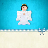 First  Communion card, happy angel. My First Holy Communion invitation card, happy angel praying  on blue background with blank space for customization Stock Photo