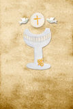 First communion card vertical parchment chalice. First communion card, chalice, wafer and pigeons, parchment background Royalty Free Stock Images