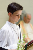 First Communion. A child receiving the religious sacrament of the first communion Royalty Free Stock Image