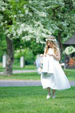 First Communion - girl looks at her gifts Stock Image