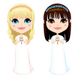 First Communion Girls. Sweet blonde and brunette girls in white dress on first communion ceremony Royalty Free Stock Images