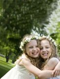 First Communion - happy day. Happy girlfriends - First Communion, smiling Royalty Free Stock Images