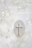 First Communion. First Holy Communion greeting card, with white prayer book cross and babys breath flowers as a symbol of purity royalty free stock photos