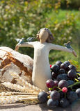 First communion. Photo with bread, grape, and angel as religious symbol stock images