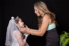 First Communion Pride. Proud mother and daughter on First Communion day Royalty Free Stock Images