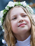 First Communion smiling girl Stock Photo