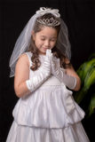 First Communion. Portrait of a young girl in a praying position for First Communion Stock Photos