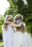 First Communion. Two girls on the walk - First Communion Royalty Free Stock Image