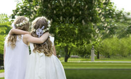 First Communion. Two girls on the walk - First Communion Stock Image