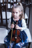 The first concert on the violin at the music school. The girl is waiting for her performance on the violin at the music school Stock Photos