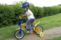First cycling. Small boy first time on bycicle Stock Image