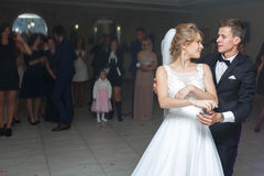 The first dance of gentle stylish happy  blonde bride and groom Stock Images