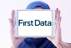 First Data Corporation logo. Logo of First Data Corporation on samsung tablet holded by arab muslim woman. First Data is a global leader in commerce enabling Royalty Free Stock Image