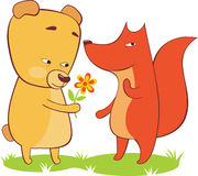 First date. The bear gives a flower to a fox Stock Image
