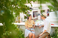 First date. Asian young couple having first date in the park stock photo