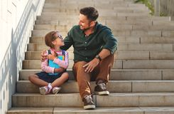 First day at school. father leads little child school girl in f. First day at school. father leads a little child school girl in first grade royalty free stock photos