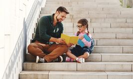 First day at school. father leads  little child school girl in first grade royalty free stock photography