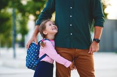 First day at school. father leads  little child school girl in f Stock Photos